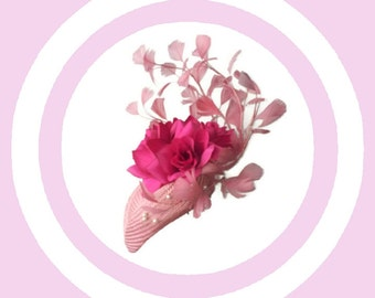 Pink straw fascinator paired with flowers and feathers, a gorgeous piece of millinery.
