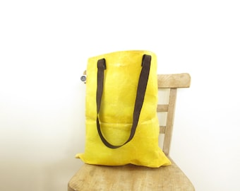 Large waxed canvas and leather tote bag made with organic cotton, natural turmeric dye and sustainable beeswax, waterproof and durable