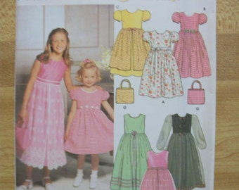 Simplicity 9497 Child's (Size HH 3,4,5,6) purse and dress with optional petticoat. 6 made easy!