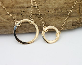 14k gold circle necklace. Solid gold necklace.  Hammered gold pendant necklace on 14K solid gold chain. Handmade. Unique, modern jewelry