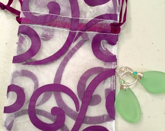 Organza purple swirl draw string gift bag.