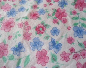 Burp Cloths with pink and blue flowers on white back ground