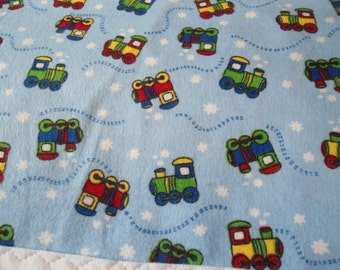 Burp Cloth with colorful train engines on blue back ground