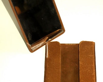 Leather cased travelling mirror