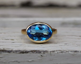 18ct yellow gold blue topaz ring, large yellow gold blue topaz ring