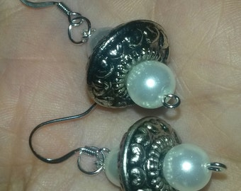 white glass pearl with silver embellishment