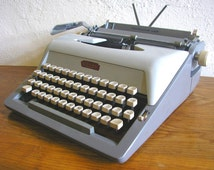 Royal Portable Working Typewriter RoyalLuxe 425 1960s metal body faux tan leather case refurbished from Netherlands Holland