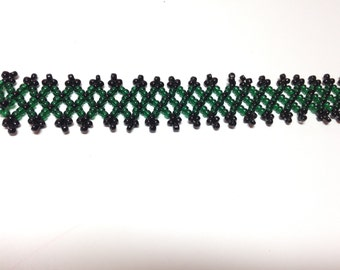 Black and green bead woven bracelet.