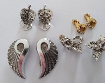 Four pairs of vintage clip on earrings