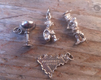 lot of four vintage sterling silver charms