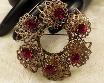 Vintage West Germany Circular Ruby Red Coloured Rhinestone Filigree Brooch