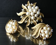 Crown Trifari set. Gold tone clip on earrings. Trifari pearl brooch. Trifari crystal earrings