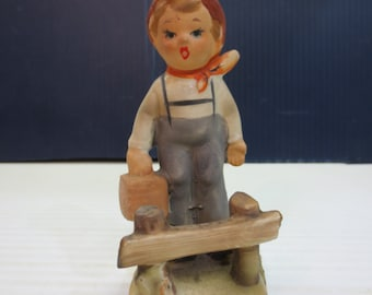 Porcelain figurine of a German boy with a picnic lunch