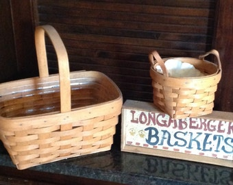 Longaberger 1991 Laurel Basket and 1991 Longaberger Spring Basket with Protector.