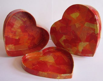 set of 2 heart shaped decoupage boxes with lids, in reds, oranges and yellows