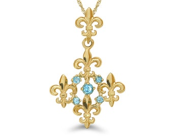 "14k solid gold fleur de lis pendant with genuine blue topaz stones on an 18"" gold chain. floral jewelry"