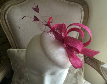 Gorgeous white round fascinator with magenta loops, feathers and netting. Stunning!