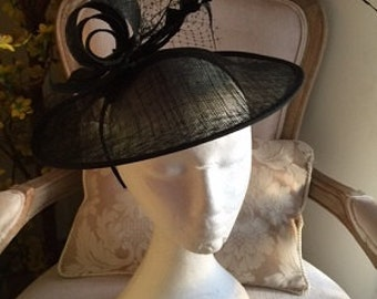 Stunning simple black hatinator with loops, netting and feathers!