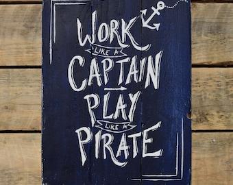 "reclaimed wood wall art - ""work like a captain play like a pirate"""