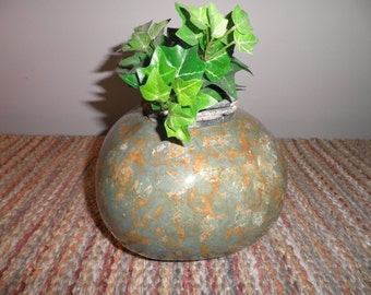 Hancrafted gourd plant holder