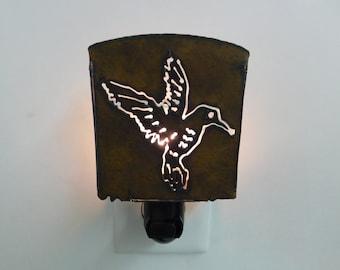 Hummingbird Nightlight image cut into rusted metal