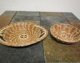 2 unique baskets very tightly woven with attractive designs.