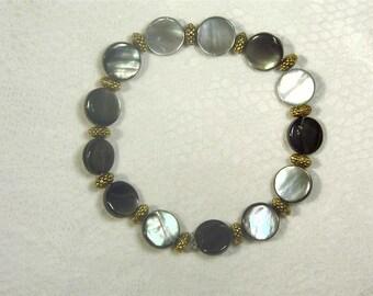 "Cynthia Lynn ""LOVELY"" Antiqued Gold Shell Stretch Bracelet"