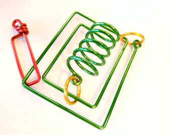 The Cabinet puzzle colorful metal spring