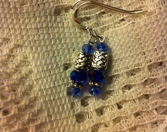 Sapphire aurora borealis and sterling silver pierced earrings with Celtic knot beads.