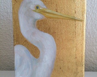 White egret on gold leaf