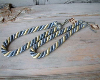 One pair french vintage thick rope curtain tie backs. Set of 2 curtain tie ropes. Pastel blue, ivory, yellow. Curtain Passementerie. NOS