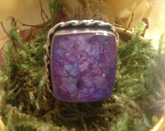 Purple fairy Crystal ring glows blue