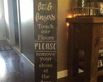 Since little fingers touch our floor please remove your shoes at the door Sign