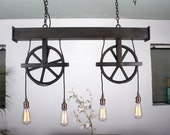 Handcrafted dual pulley 4 light chandelier with steel beam