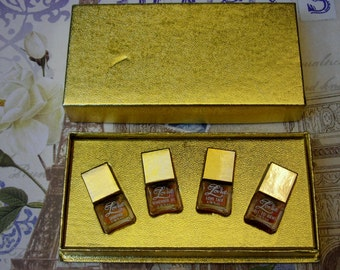 vintage Lovue miniature perfume set by Shaklee; contains Call to Arms, Sharina, Remember Me, Love Talk.