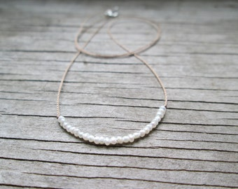 Tiny freshwater seed pearl necklace on a silk cord, June birthstone necklace, bridesmaid necklace