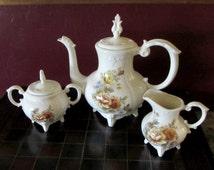 Loma Tea Service Studio China Mid Century Embossed Floral, Teapot, Sugar Bowl and Creamer Pottery Set