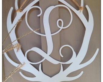 Letter with antlers