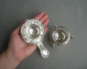 Romantic lovely antique solid silver tea strainer with a holder, Germany.