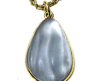 JACQUES ESTEREL, vintage gold-tone metal and resin pendant