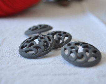 4 perforated grey buttons