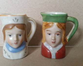 A Pair of Mini Toby Character Pitchers