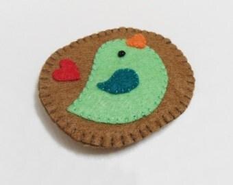 Bird brooch, green felt