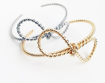 Modern and chic rope texture bow sculpted bracelet in gold and silver plate