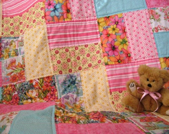 Pastel floral quilt throw