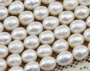 10mm A freshwater oval pearl strand,rice pearl strand,cheap price pearls,large hole pearls,1.0mm,1.5mm,1.8mm,2.0mm,2.2mm,2.5mm,2.8mm,3.0mm