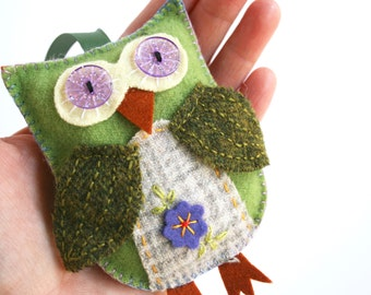 Green wool felt owl ornament with sparkly purple eyes and hand embroidery