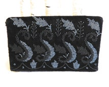 Vintage black velvet bag with black & iridescent blue seed beads on fold over flap, long black cord handle, can be worn various ways, 1980s