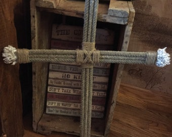 Rope Cross. Lariat ropes upcycled into a rustic cross with jute twine accents and blue frayed ends. Cowboy Cross decor. Western Home Accents