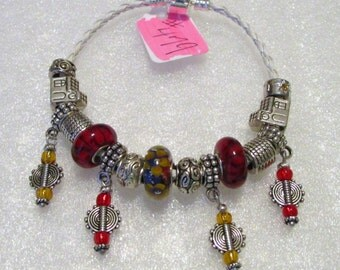 479 - CLEARANCE - Red Gold Blue Dangle Bracelet